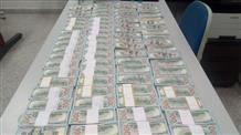 Греки арестовали россиянина с полным чемоданом денег